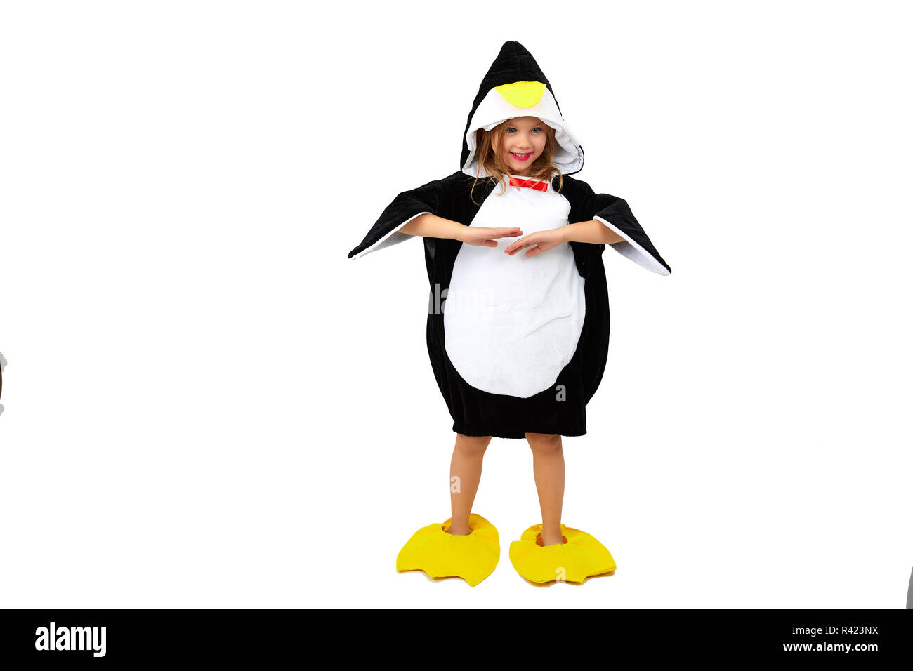 d53ab5acdfb3d Little girl in a clothing of penguin isolated on the white background -  Stock Image