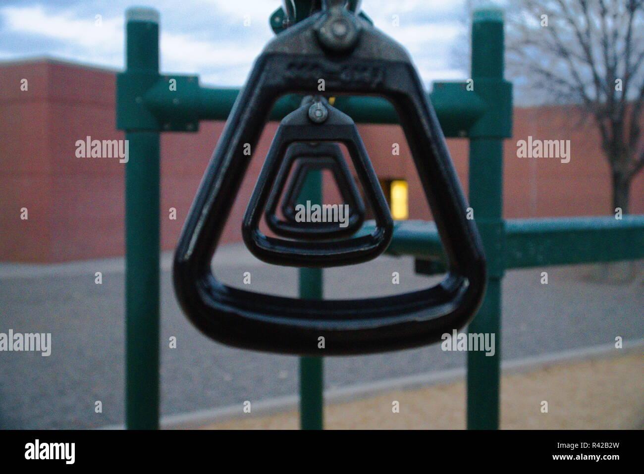 A shot of handlebars playground equipment at a park. - Stock Image
