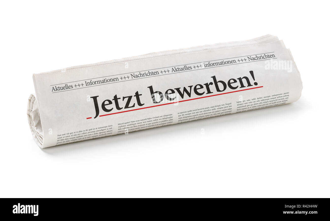 newspaper roll with the heading now apply Stock Photo