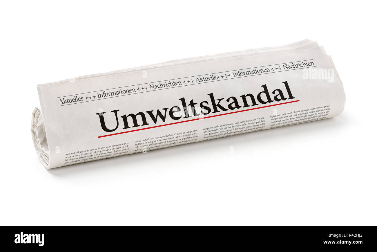 newspaper roll with the heading environmental scandal Stock Photo