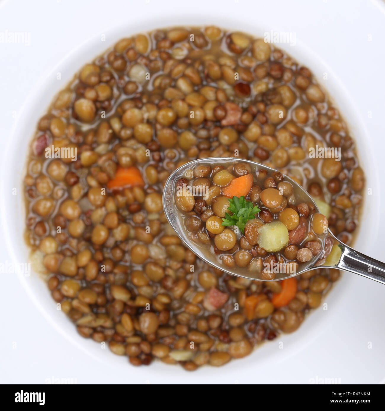 lentil soup eat lentils soup spoon from above healthy eating Stock Photo