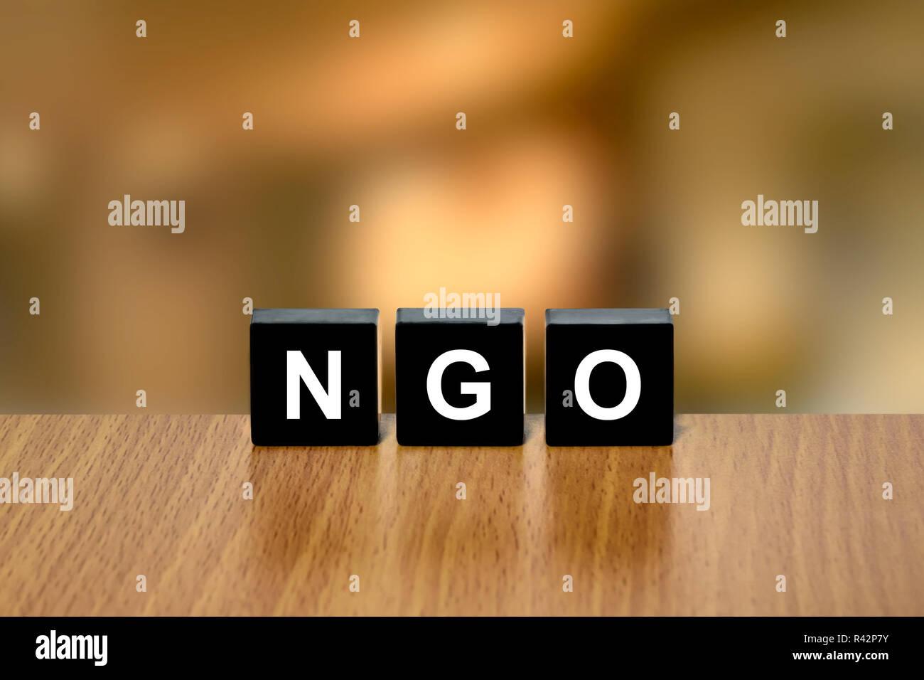 NGO or non-governmental organization on black block - Stock Image