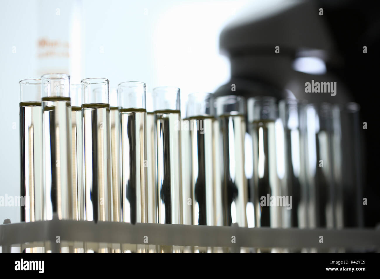 Yellow liquid spilled petrol additive innovative supply - Stock Image