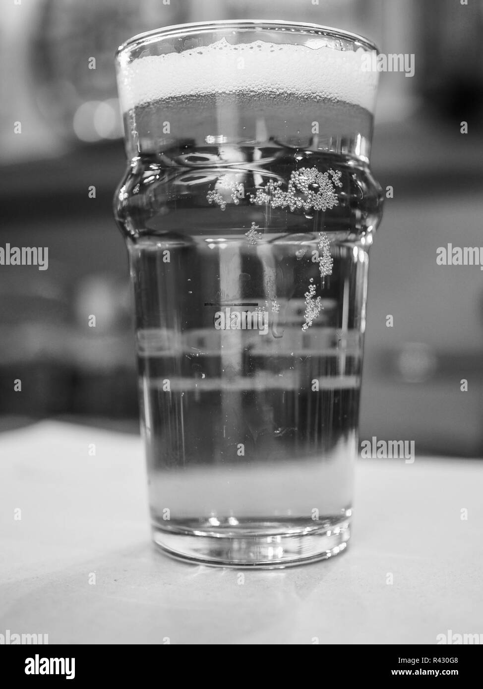 Black and white Pint of British ale beer - Stock Image