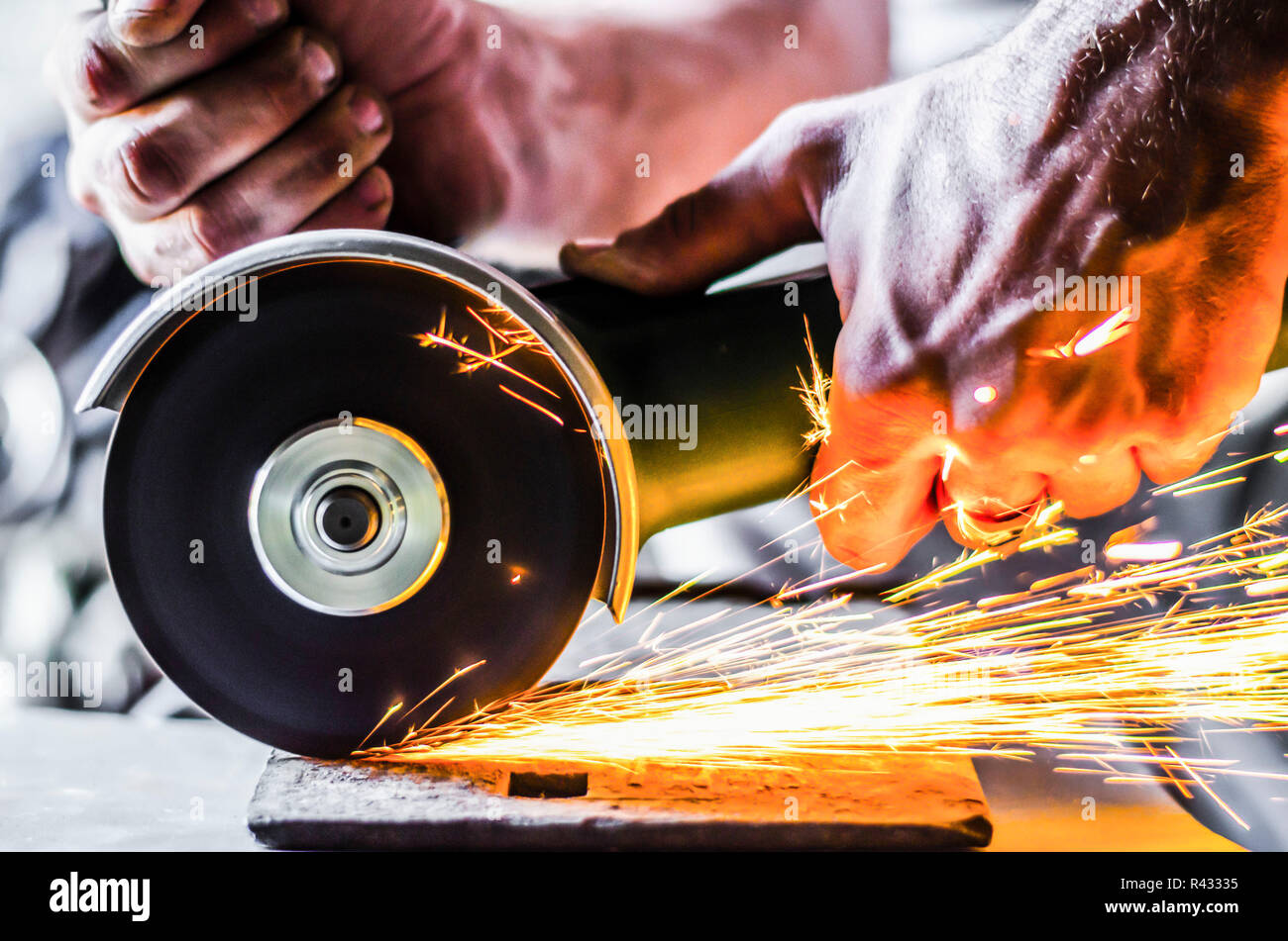 Sparks from the angle grinder - Stock Image