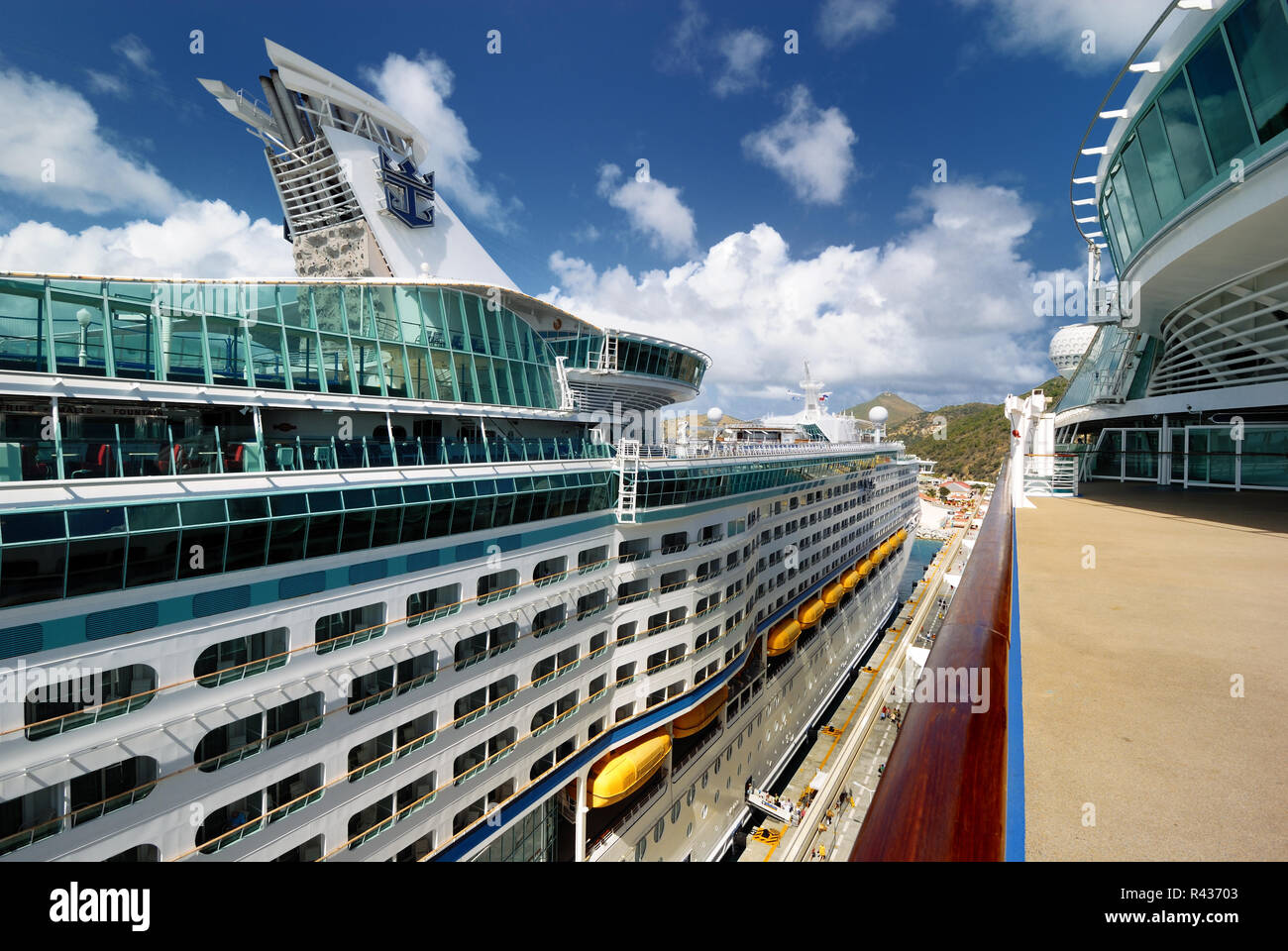 A view of Royal Carirbbean's Explorer of the Seas as viewed from the upper deck of the Adventure of the Seas, docked at St. Maarten. - Stock Image
