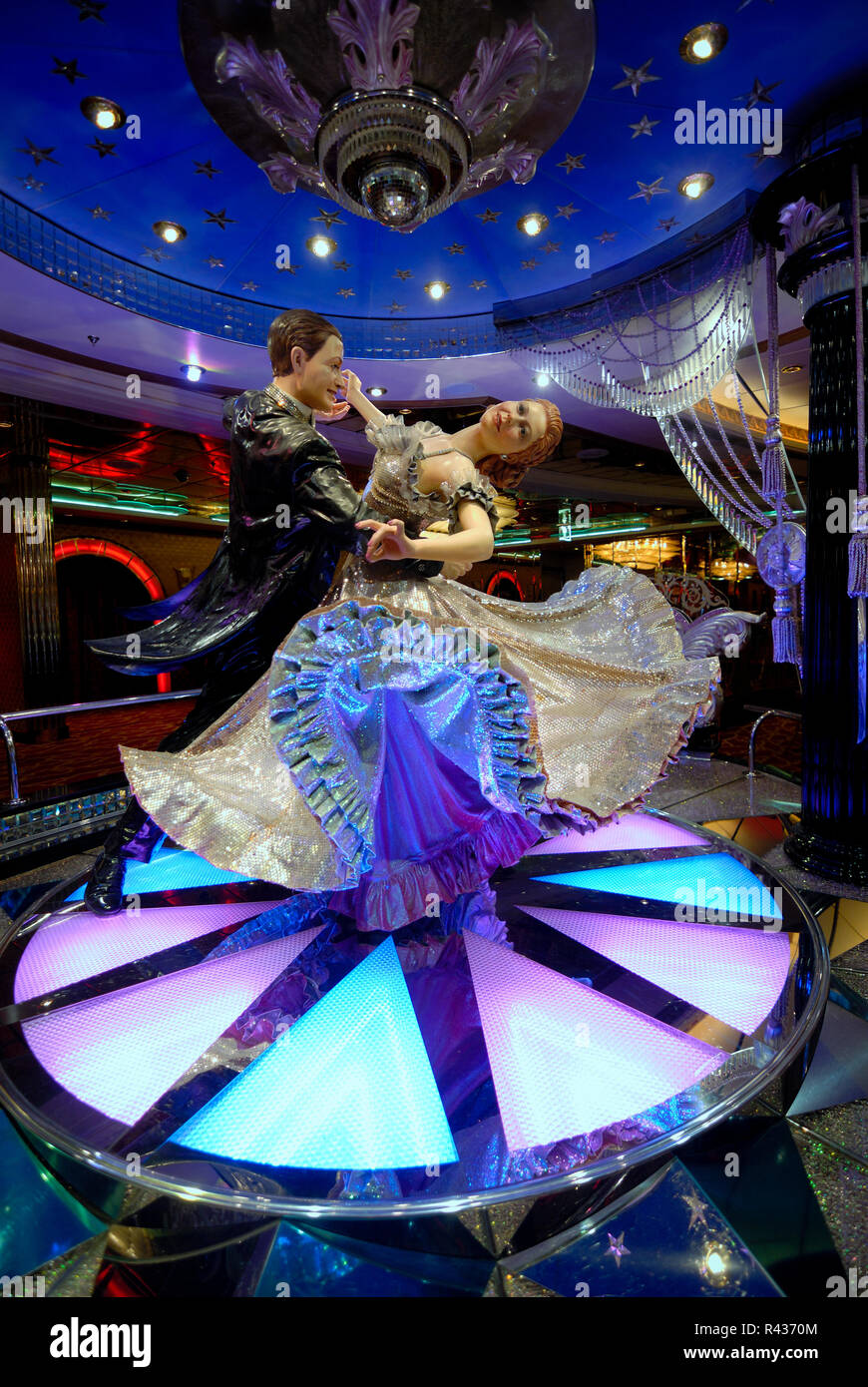 This statue of two ballroom dancers is located in the casino on the Royal Caribbean cruise ship Adventure of the Seas. - Stock Image