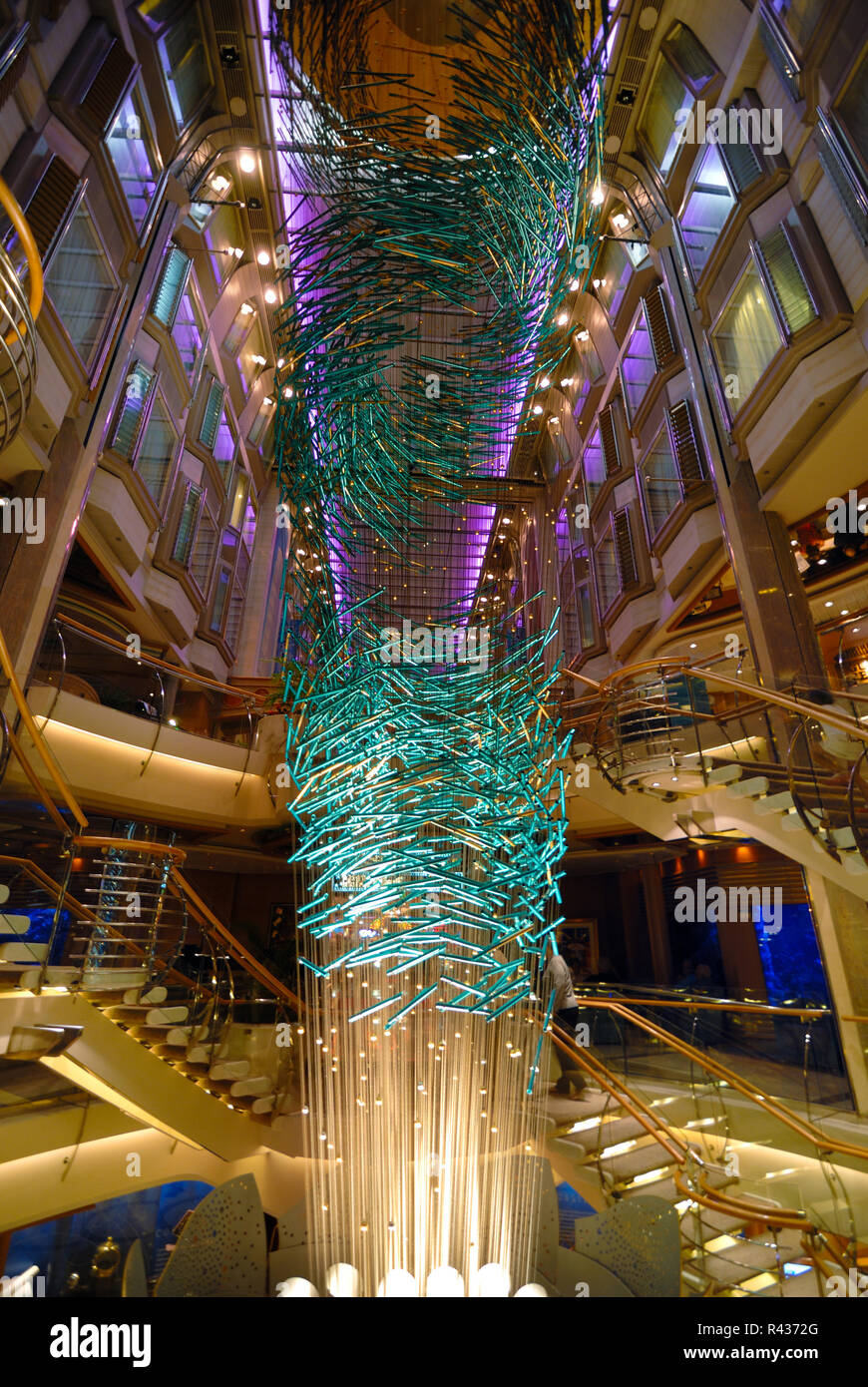 A colorful art piece with dramatic colors and lightings amidst stairways on the Royal Caribbean cruise ship Adventure of the Seas - Stock Image
