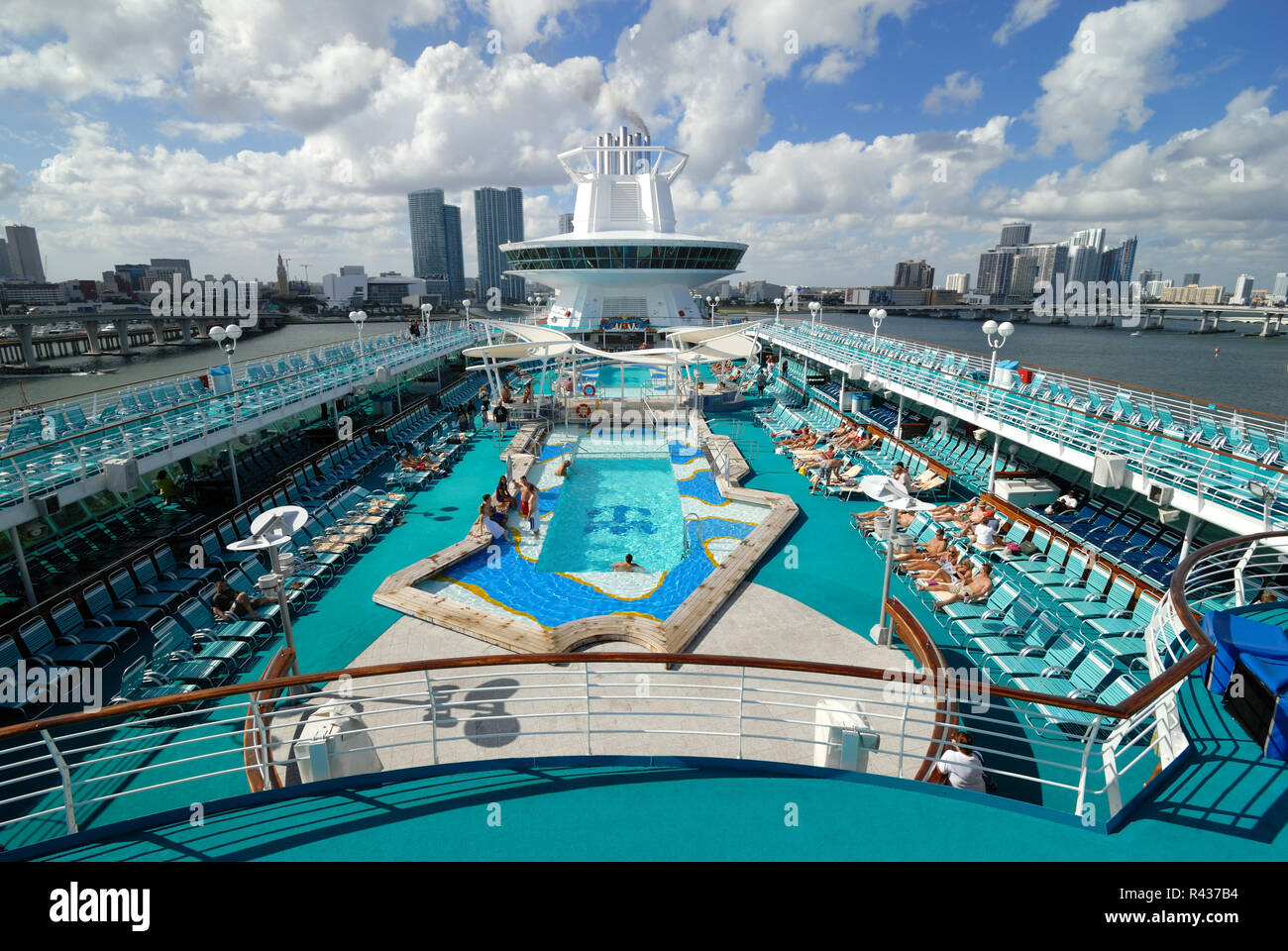 The pool deck on Royal Caribbean Interational's Majesty of the Seas cruise ship, against the Miami, Florida background. - Stock Image