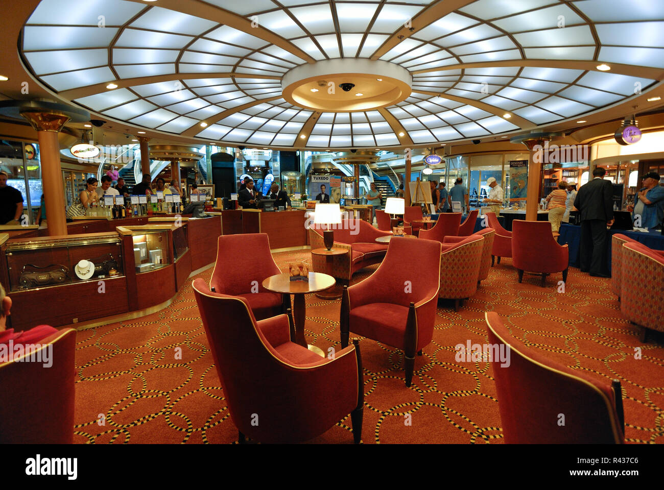 Comfortable chairs are in the center of the on board shopping area on Royal Carribean's Majesty of the Seas cruise ship. - Stock Image