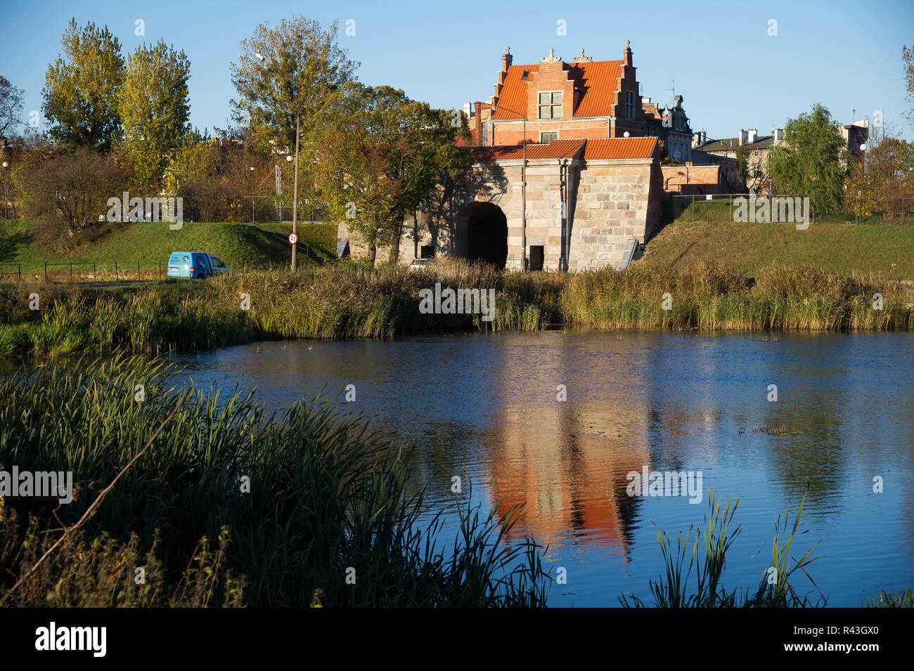 Renaissance Brama Nizinna (Lowland Gate) built by Jan Strakowski in XVII century is a part of early modern era fortifications of Gdansk, in Lower City - Stock Image