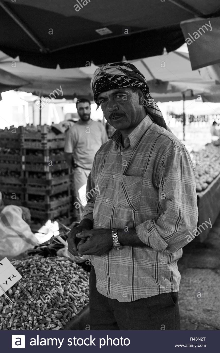 Local Bazaar of Foca with Various Food Merchants, Tradesmen and Criers. Foca, Izmir / Turkey: Summer 2007 by Hulki Okan Tabak - Stock Image