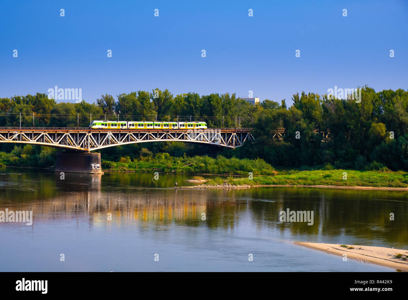 Warsaw, Mazovia / Poland - 2018/09/02: Panoramic view of the Vistula river with Most Srednicowy railway bridge and wooded Praga district of Warsaw - Stock Image