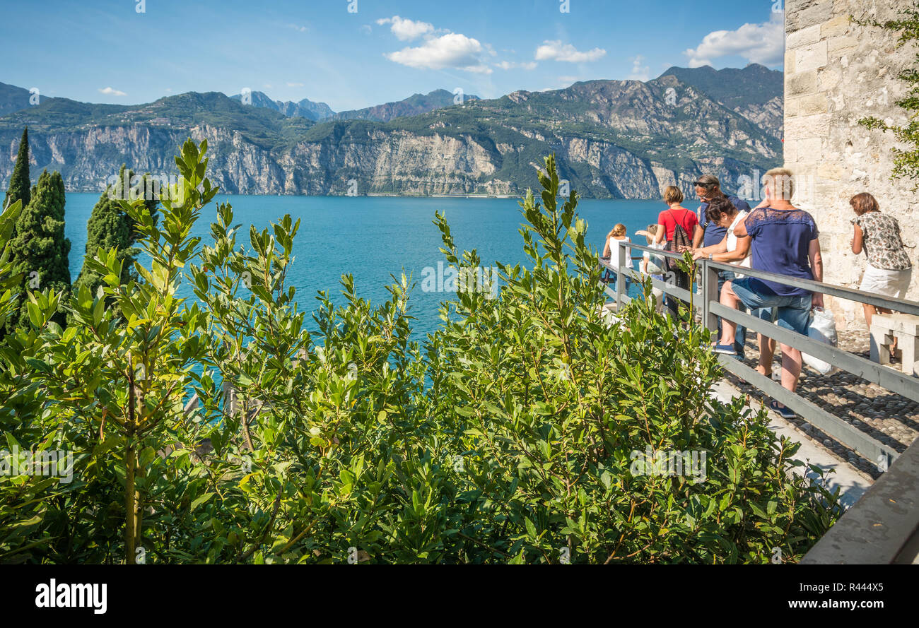View of Lake Garda from castle walls of Malcesine, Verona, Italy. The Scaliger Castle is situated along the picturesque coastline Stock Photo