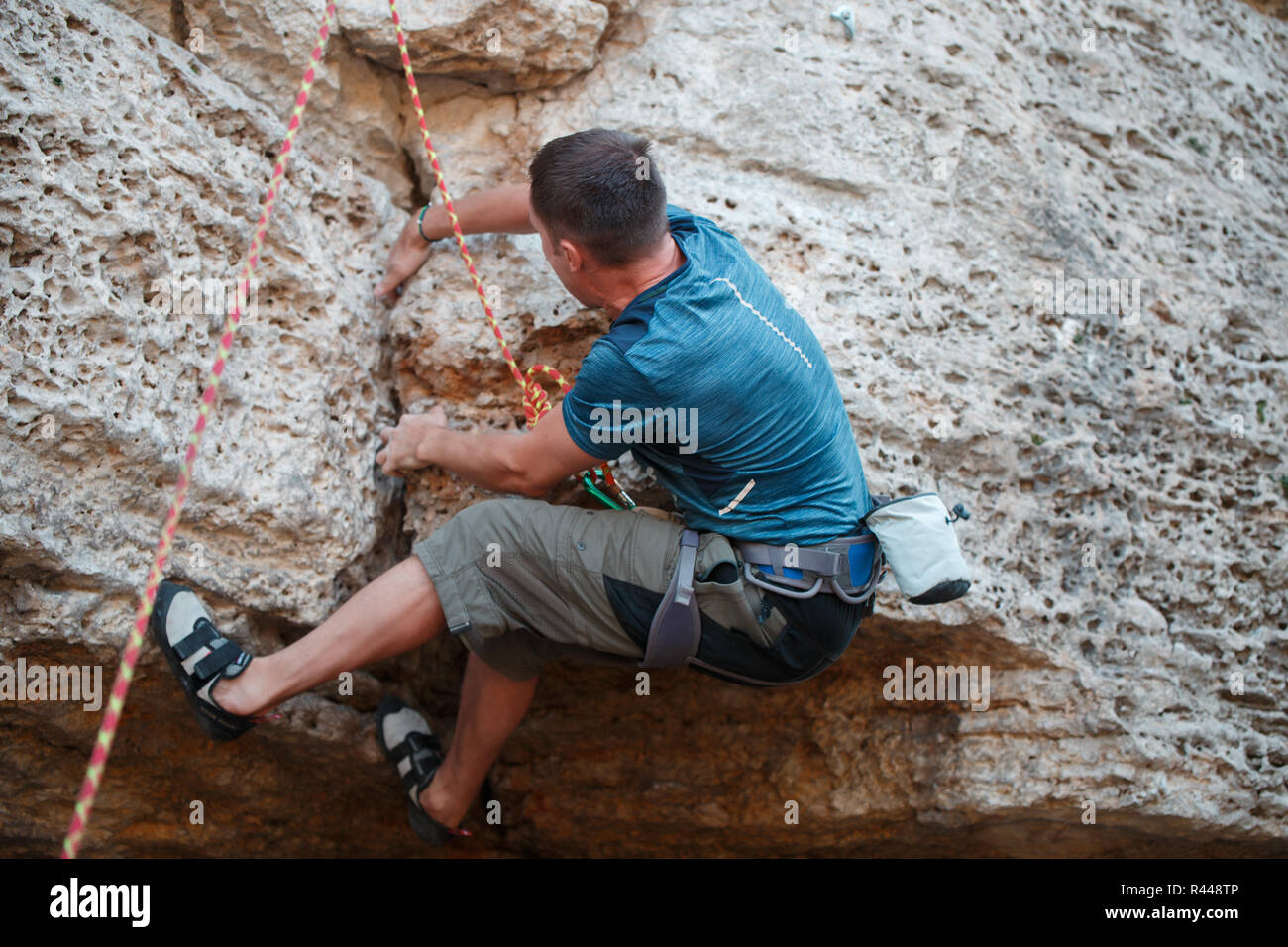 Image from back of rock climber - Stock Image