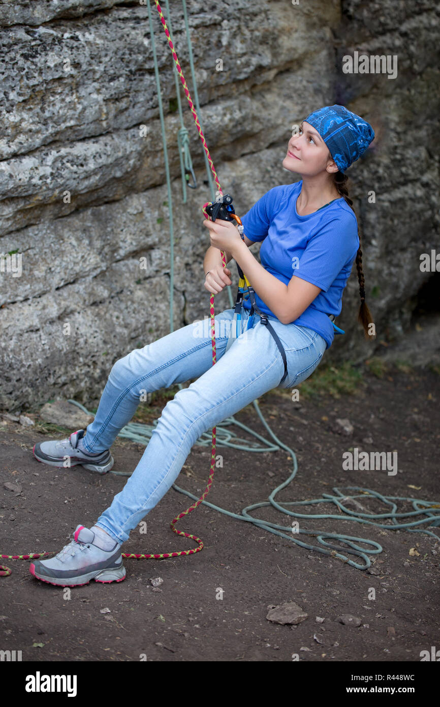 Photo of woman climbing in rock - Stock Image
