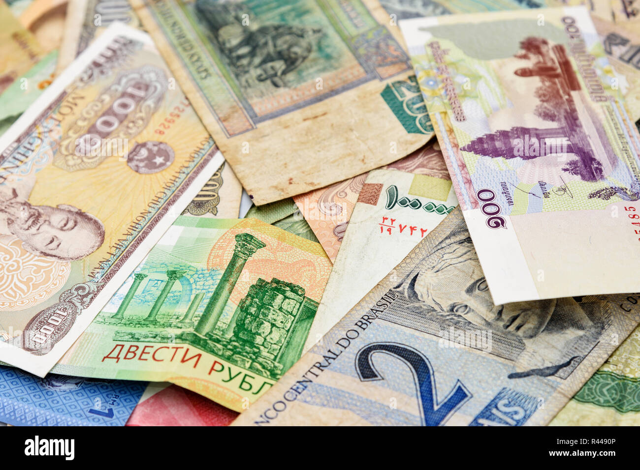 Cash money from different countries background - Stock Image