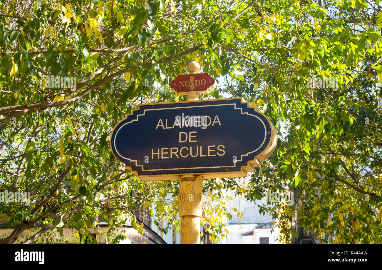 Street sign for the Alameda de Hercules, a wide treelined walk in Seville, Spain - Stock Image