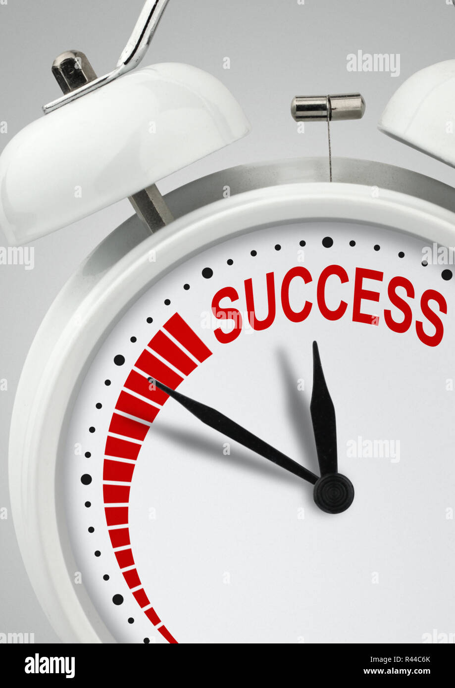 Time to success concept, long way to success, clock with inscription close-up - Stock Image
