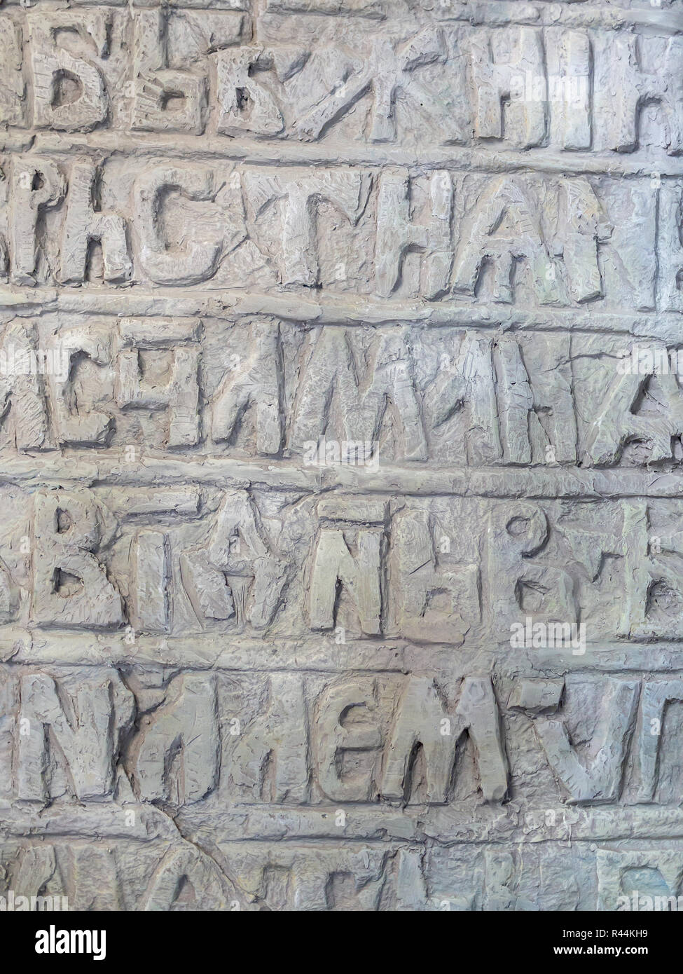 Ancient Slavic illegible inscriptions on a stone, background, texture - Stock Image