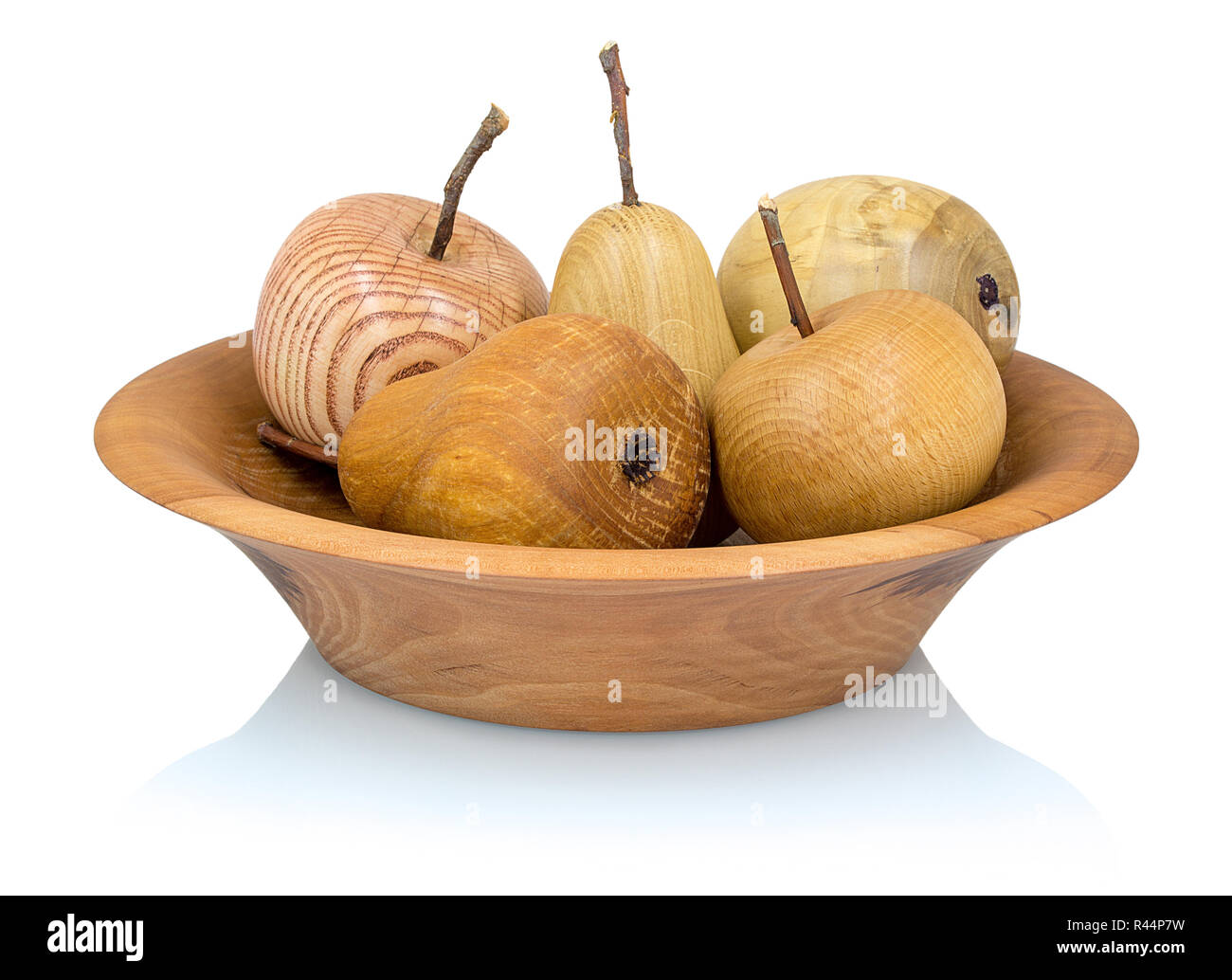 Wooden apples and pears in a fruit bowl made from a different types of wood isolated on white background with shadow reflection. Perfect arranged hand - Stock Image