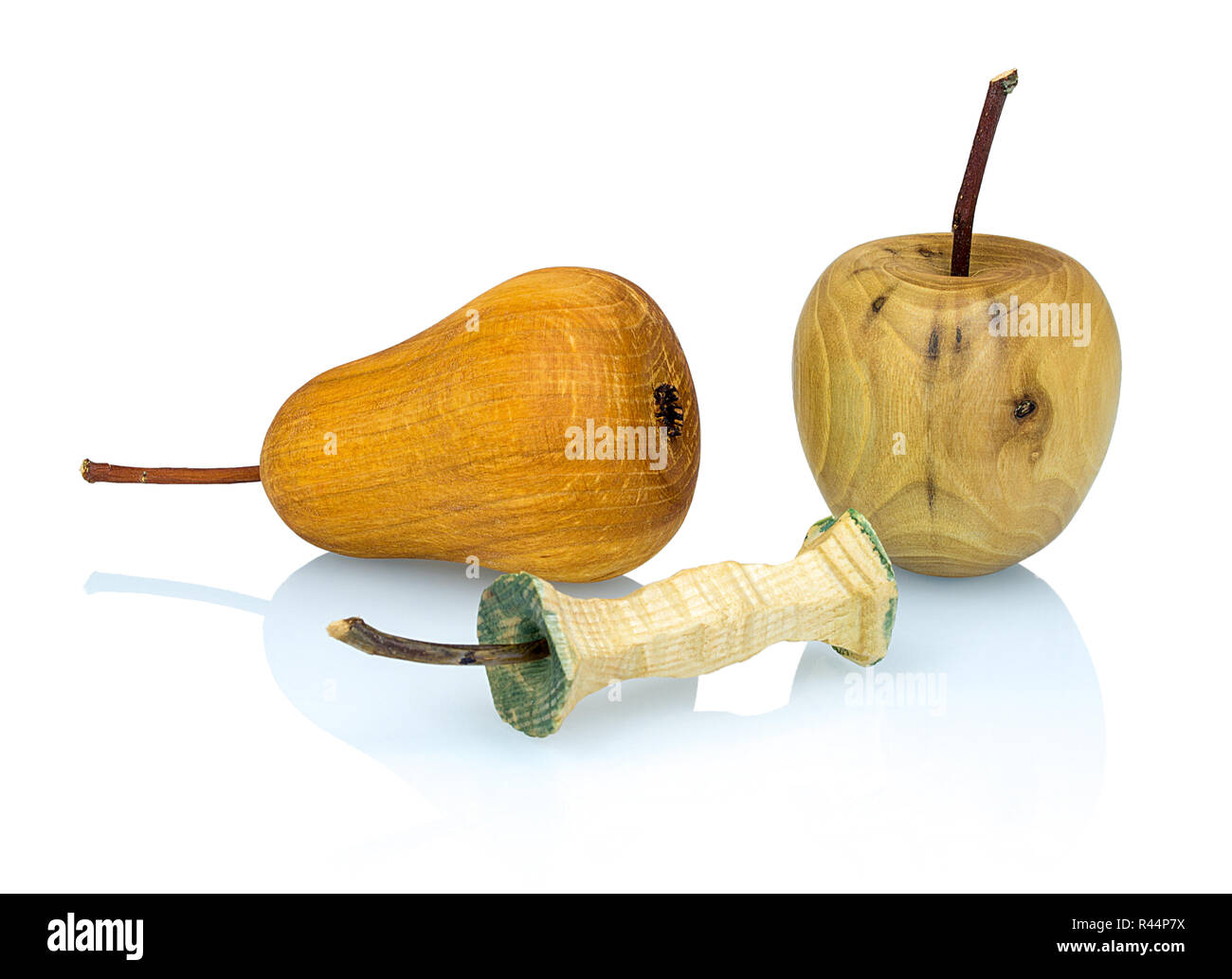 Wooden apple, apple stub and pear  made from a different types of wood isolated on white background with shadow reflection. Perfect arranged handcraft - Stock Image