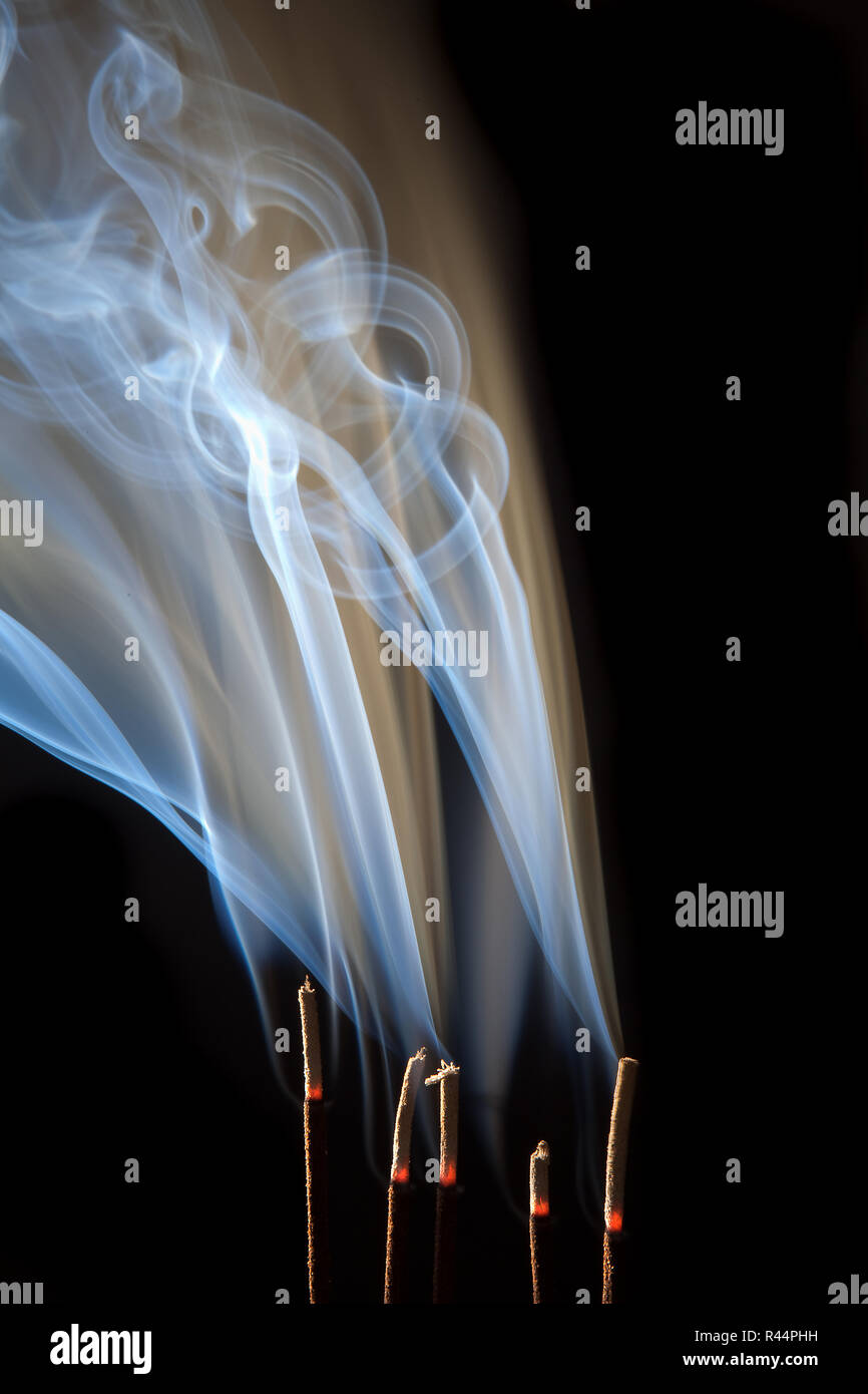 Incense burning with beautiful smoke fumes and wisps Stock Photo ...