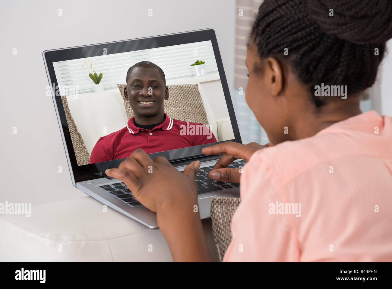 Woman Video Chatting With Man On Laptop - Stock Image