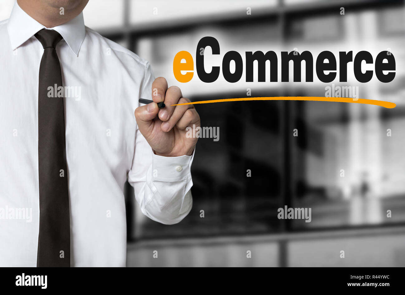 ecommerce is written by businessman background concept - Stock Image