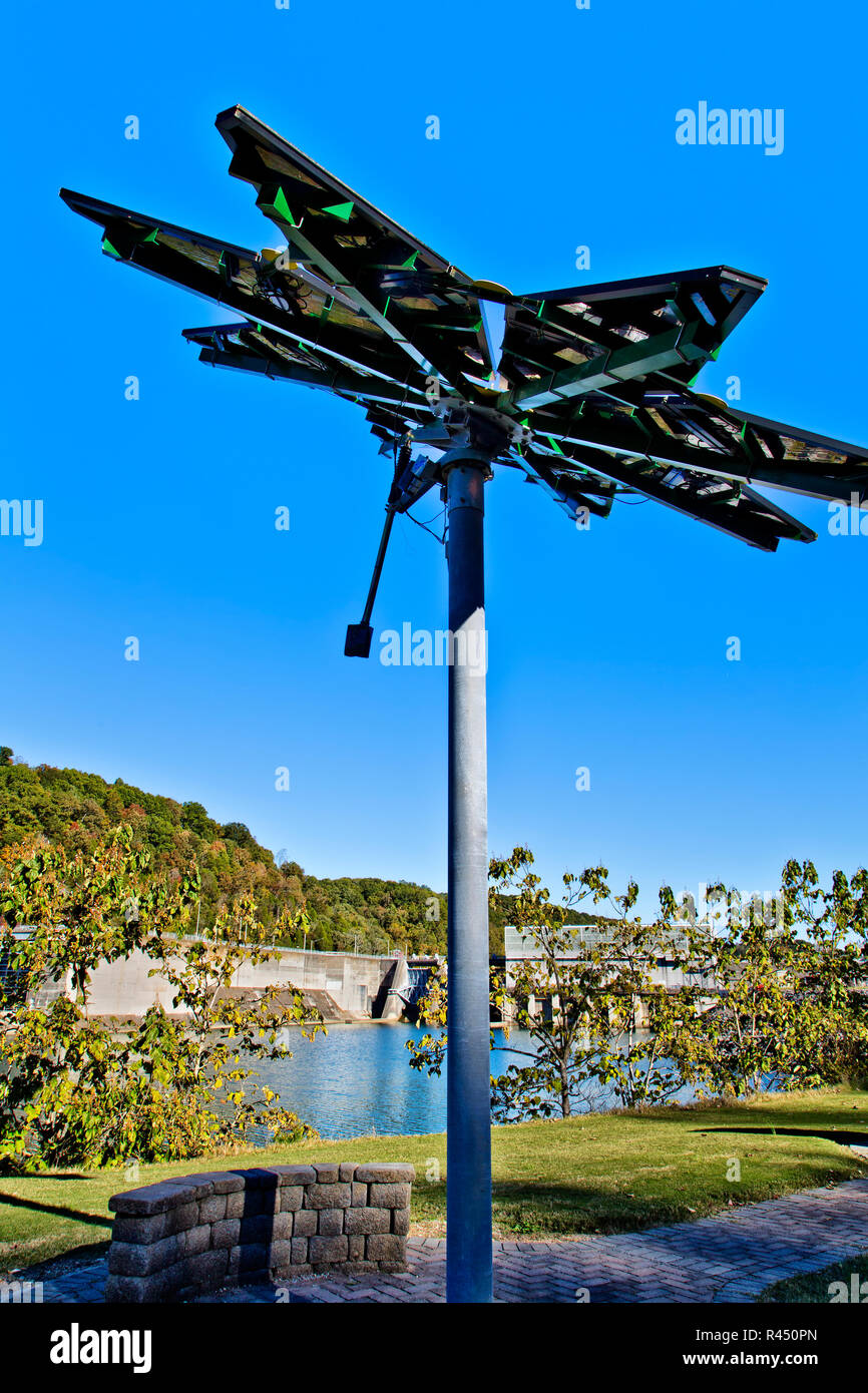 Elevated Solar Array, identified as a 'Solar Photovoltaic Flair', Vehicle charge station. - Stock Image