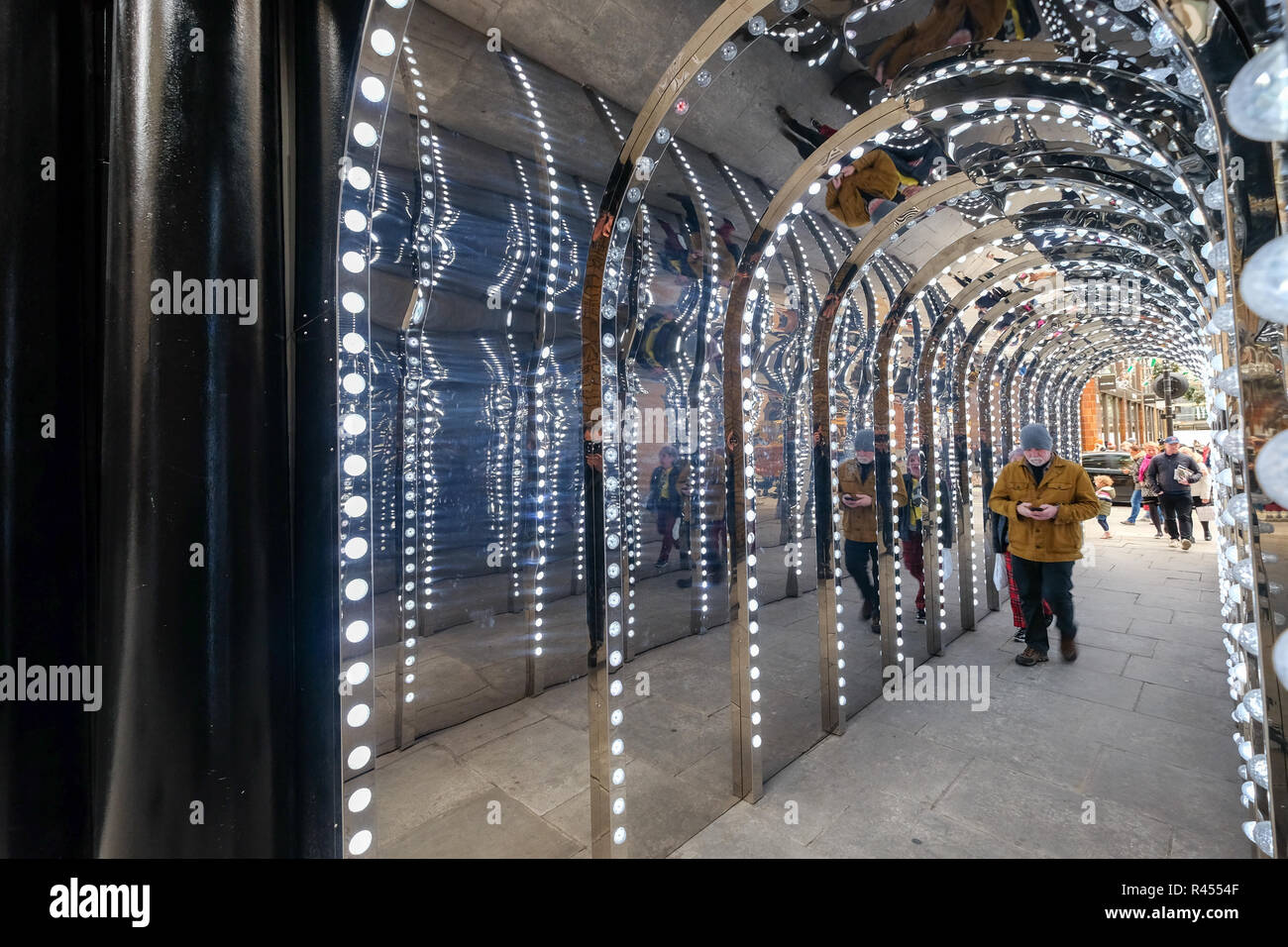 Covent Garden, London, UK.  25th November 2018. The passage to Conduit Court is covered with mirrors and lights. Stock Photo