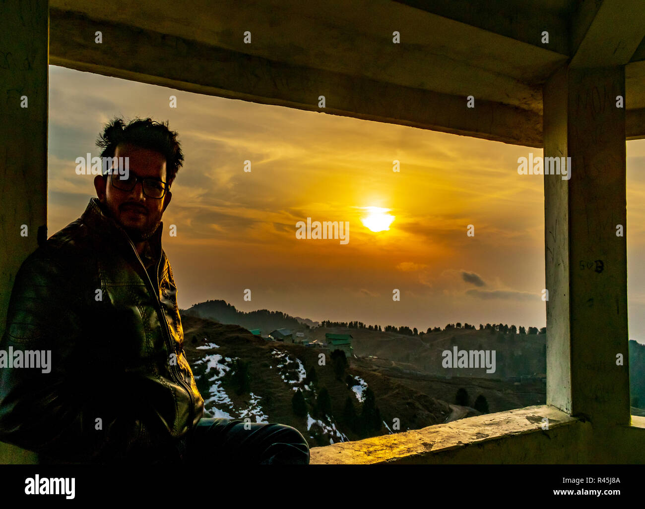 Dying embers of the setting sun- Dainkund Hills, self portrait, sunset sky in the background, from the top of the hill/ mountain, resting Stock Photo