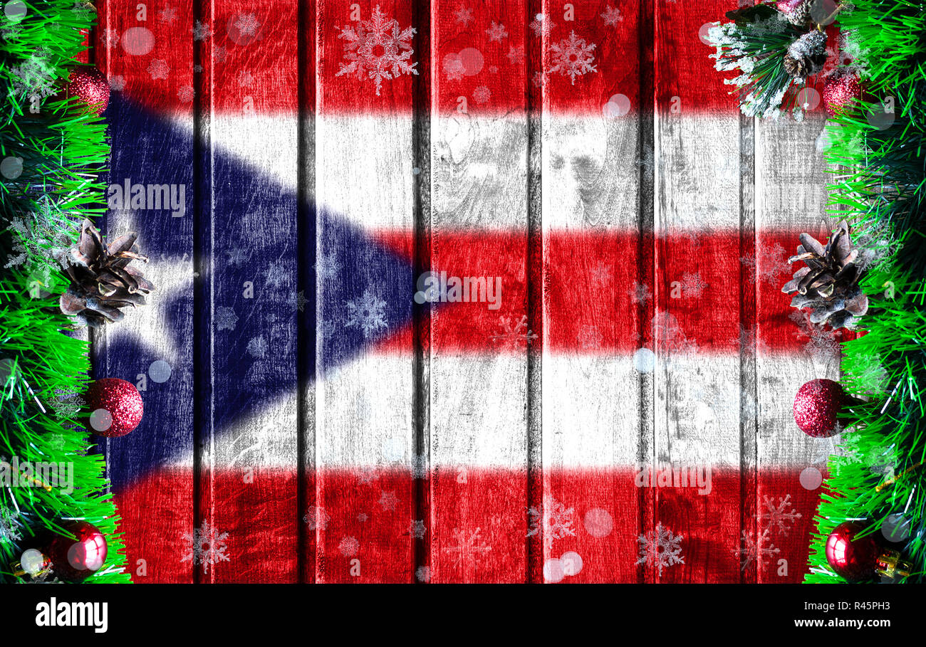 Christmas In Puerto Rico.Wooden Christmas Background With Blurred Flag Of Puerto Rico