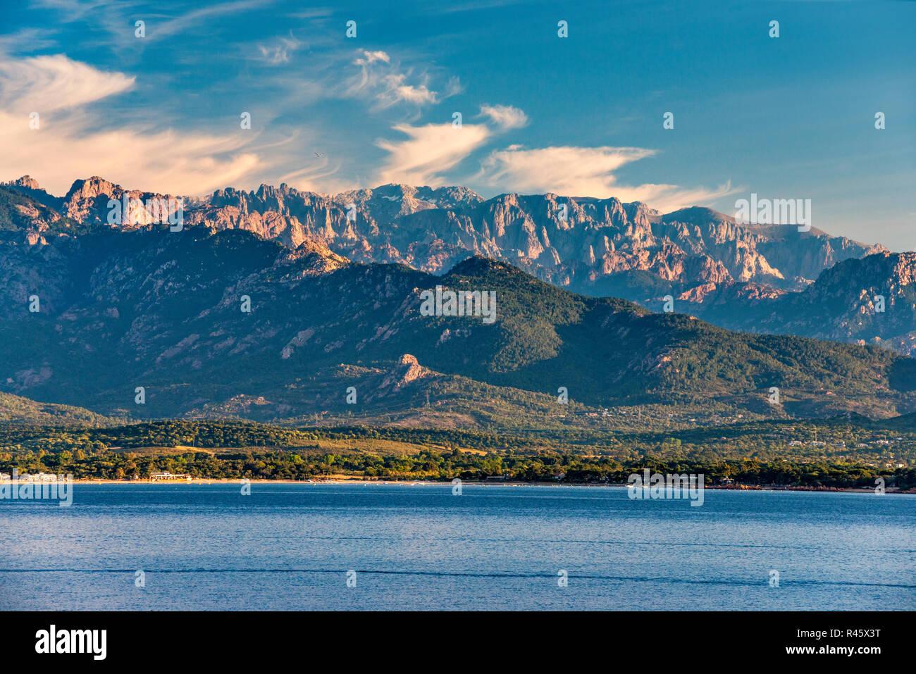 Aiguilles de Bavella and Monte Incudine massif, sunrise, Golfe de Porto-Vecchio, Tyrrhenian Sea, near Porto-Vecchio, Corse-du-Sud, Corsica, France Stock Photo