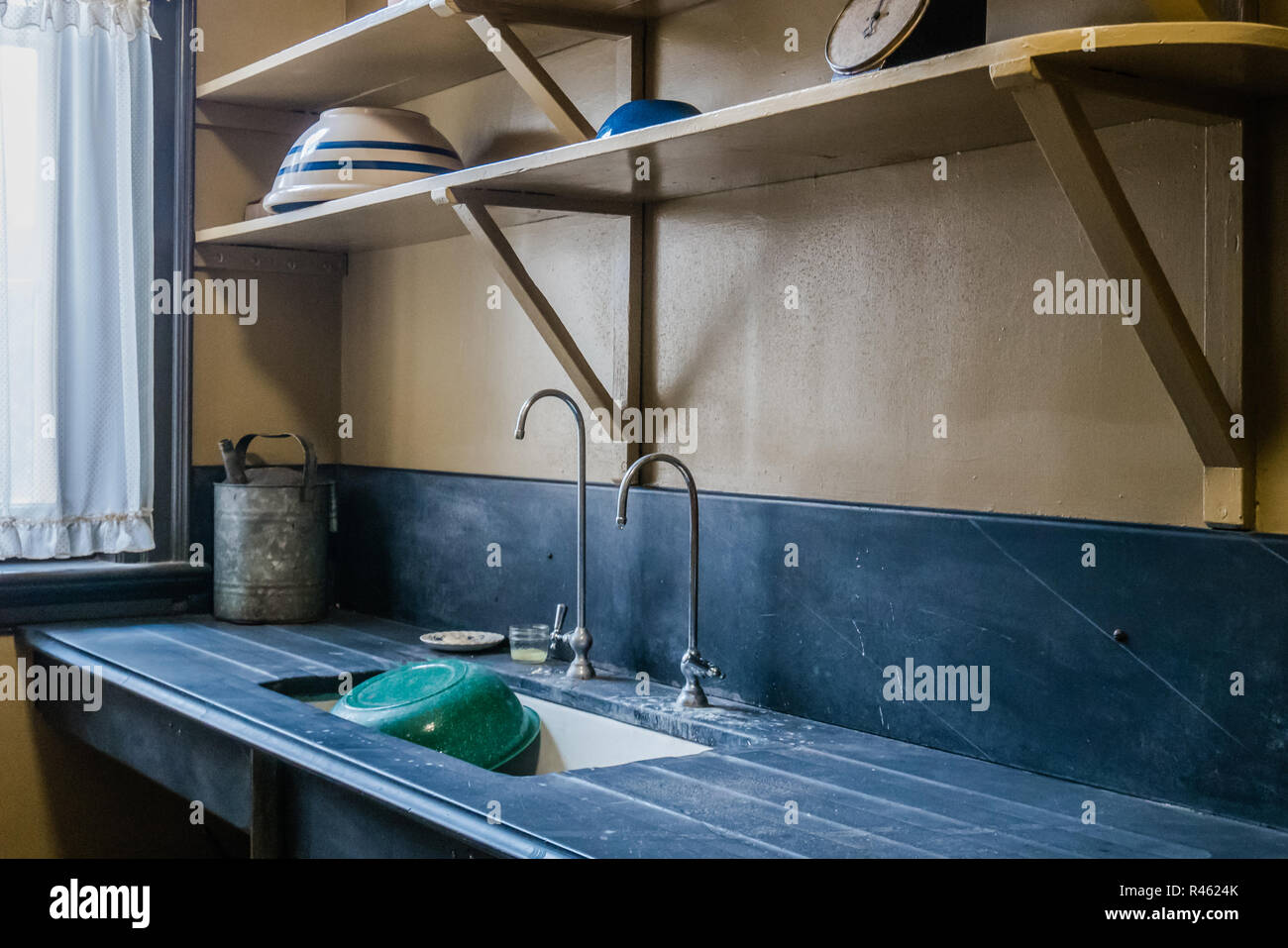 old kitchen sink and washing area modeled after 1920s wealthy north american home - Stock Image