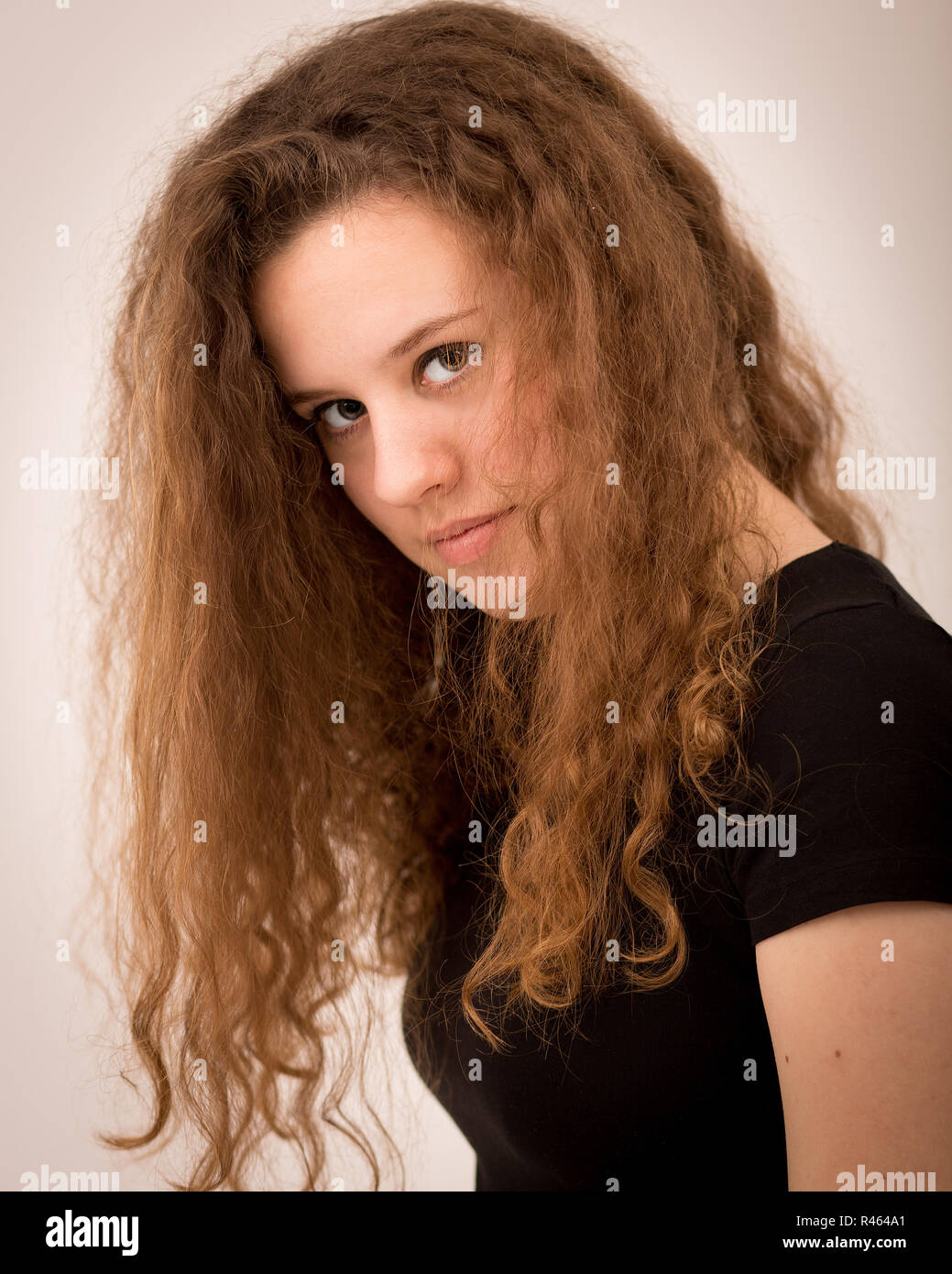 Teenager Woman With Long Curly Ginger Hair Stock Photo