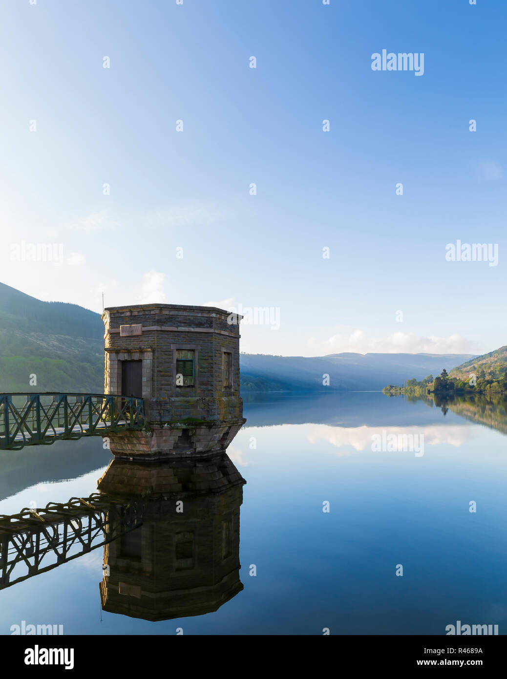 An image of a water tower on a misty October morning situated at Talybont On Usk reservoir, Wales, UK. - Stock Image