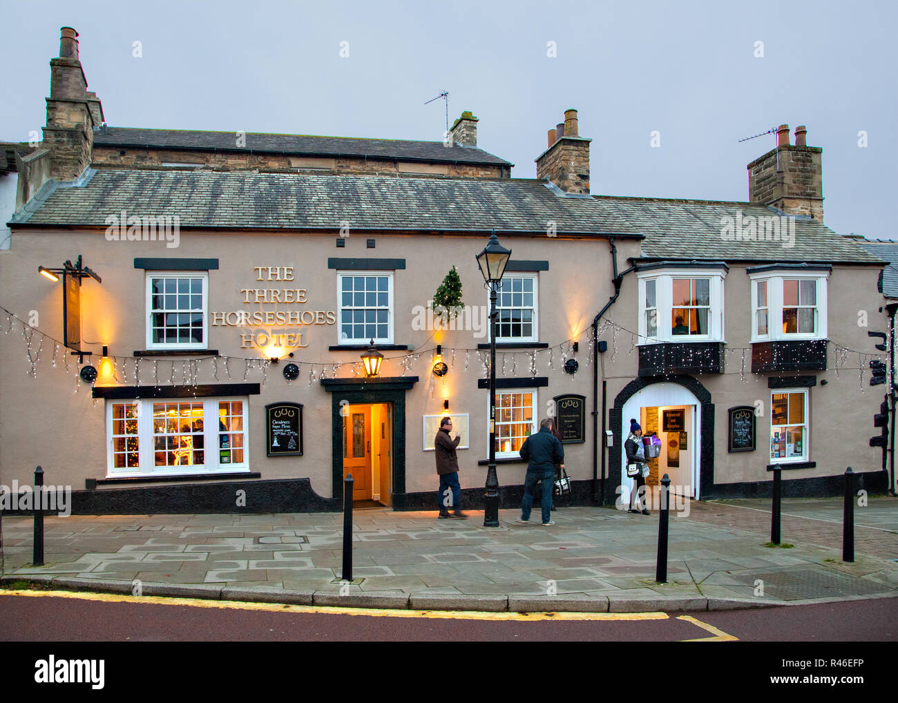Evening view of the Three horseshoes hotel pub lit by floodlights in the County Durham market town of Barnard Castle North  Pennines England UK - Stock Image