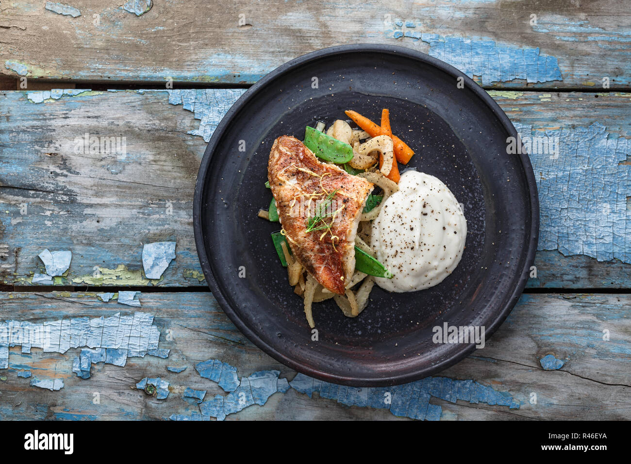Pan fried ocean perch with sauteeed fennel and jerusalem artishoke puree, copy space - Stock Image