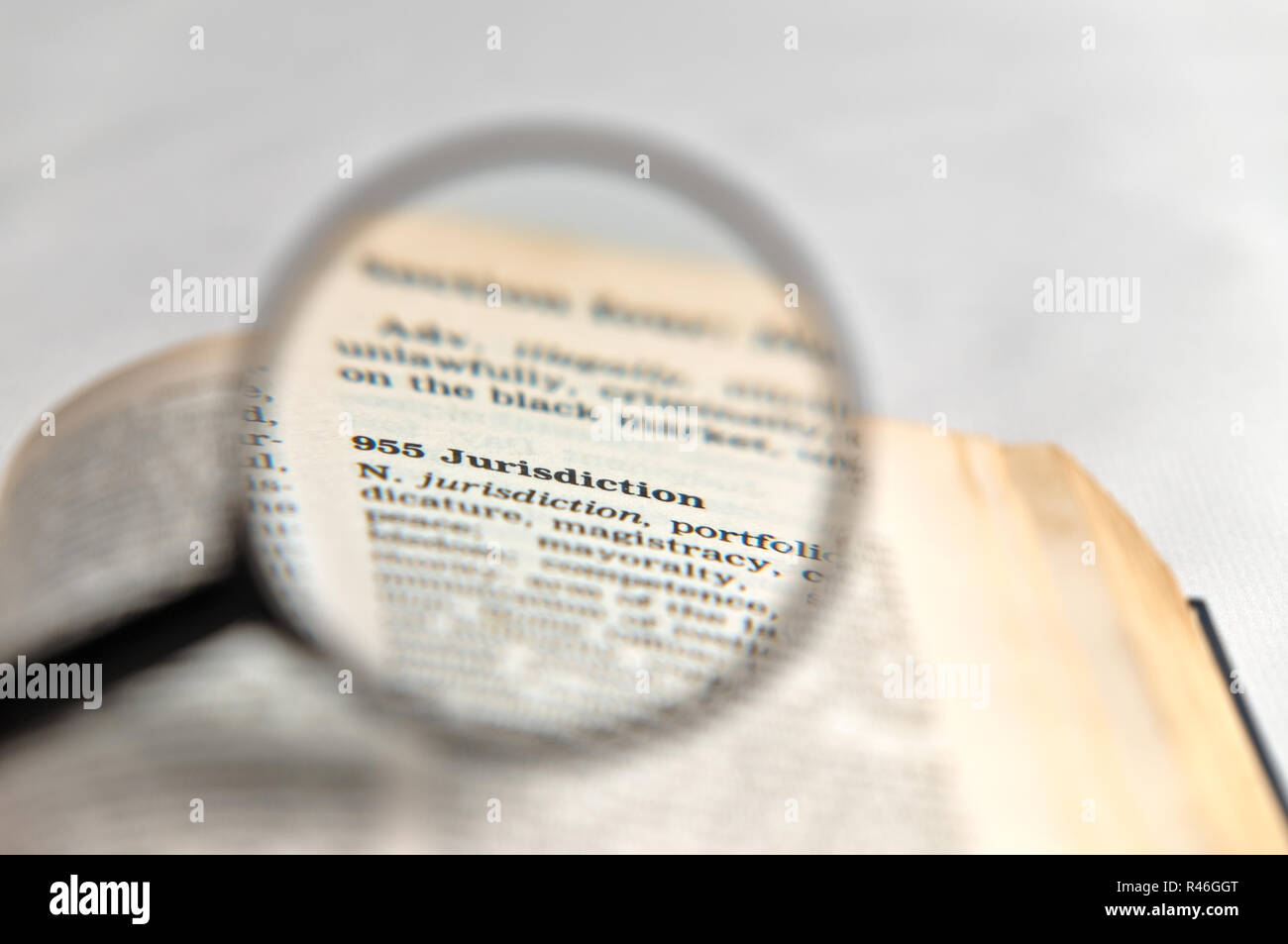 Jurisdiction word magnified on book Stock Photo