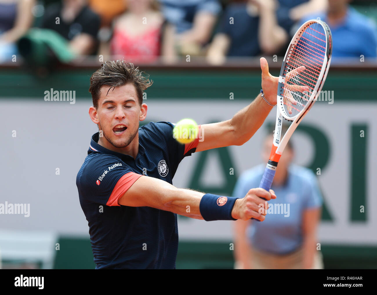 Austrian tennis player Dominic Thiem playing backhand shot at the French Open 2018, Paris, France - Stock Image