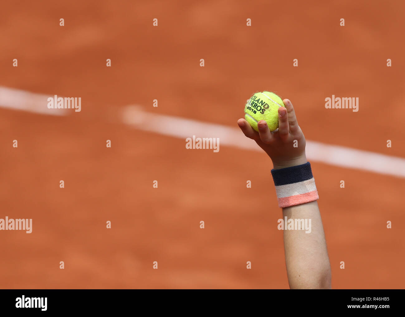 Hand of ball girl holding up ball  during French Open 2018, Paris, France - Stock Image