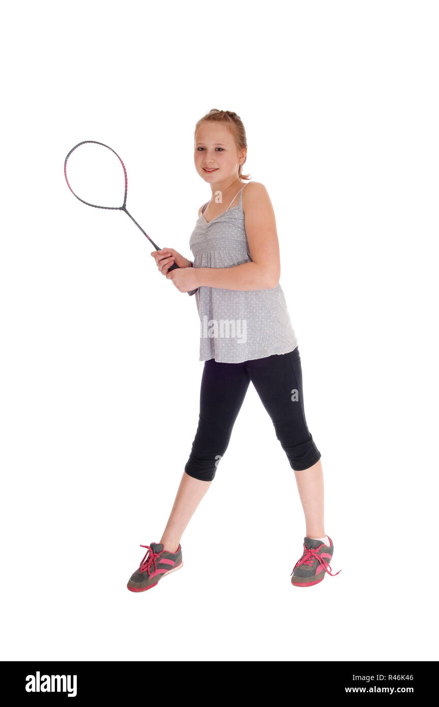 Young blond girl with her tennis racquet. - Stock Image