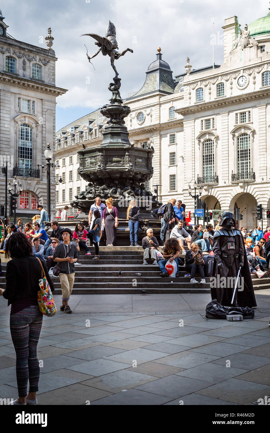 Statue of Eros or Anteros  with Darth Vader street performer in Picadilly Circus, London, UK on 12 August 2013 - Stock Image