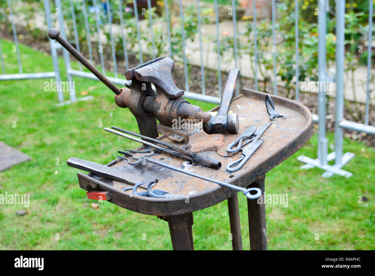 Antique Blacksmith Tools On Small Cast Iron Workbench Stock