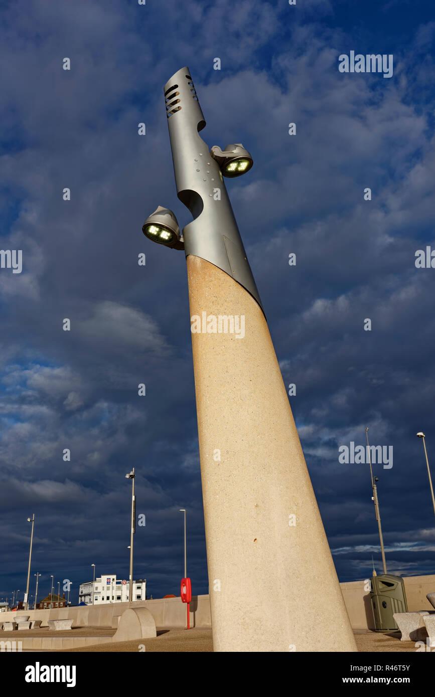 Concrete lighting column with illuminated lighting fixtures on cleveleys promenade on the fylde coast in lancashire uk - Stock Image