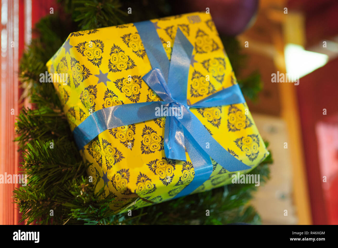 Box Christbaumkugeln.Christmas Interior Decoration In The Form Of A Yellow Gift Box Stock