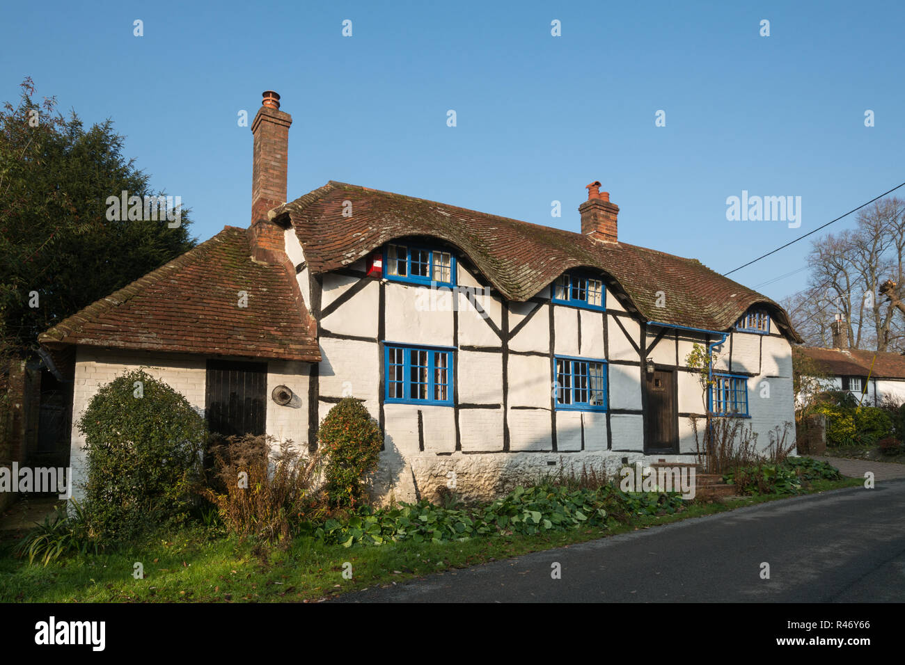 Pretty half timbered cottage in Church Street in the village of Upper Farringdon in Hampshire, UK - Stock Image
