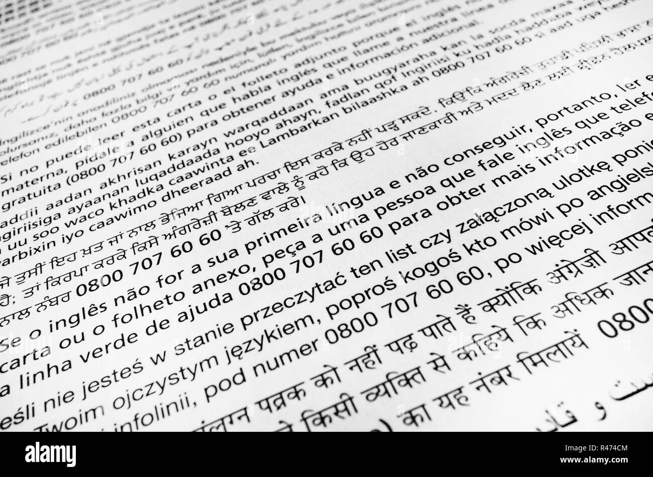Closeup of translations in various languages to the NHS Bowel Cancer home testing kit instructions Stock Photo