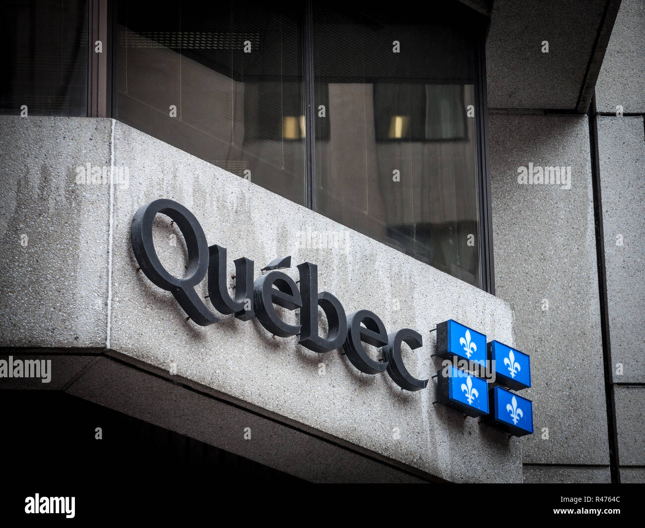 MONTREAL, CANADA - NOVEMBER 3, 2018: Logo of the provincial government of Quebec (Gouvernement du Quebec) on administrative building. Quebec is the ma - Stock Image